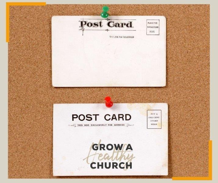 Postcards on cork board